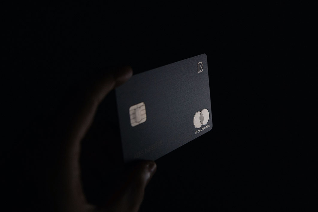 person holding black credit card