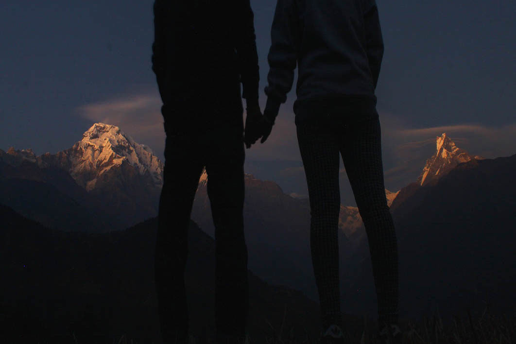 two_people_holding_hands