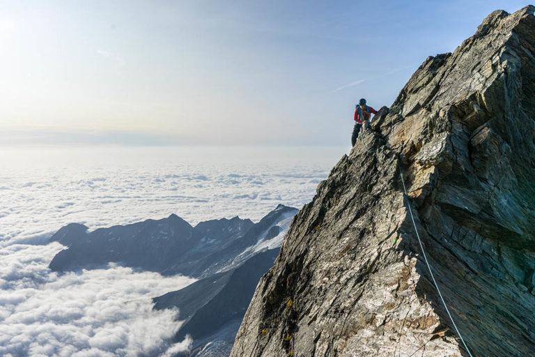 man_climbing_mountain
