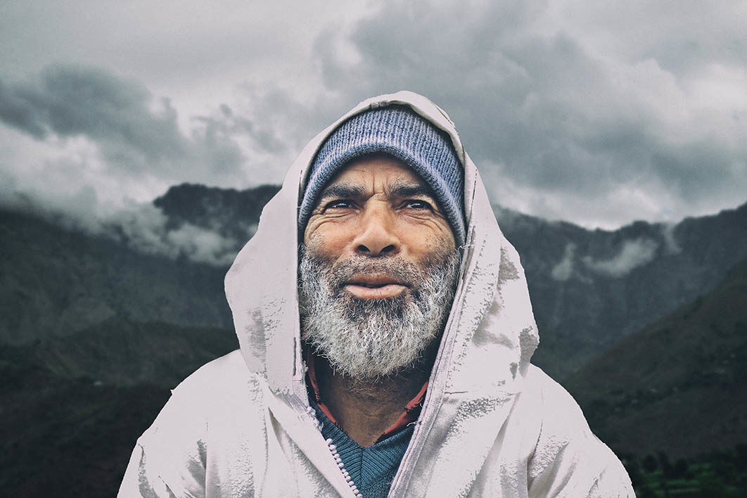 man_smiling_on_mountain